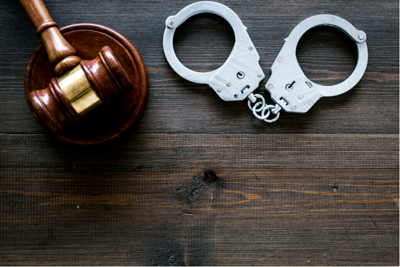 Judge's gavel and handcuffs