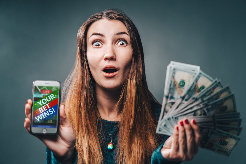 a woman shows ewoman wins money on sports betting