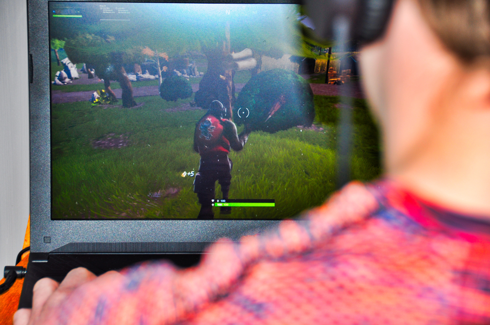 male-playing-fortnite-on-desktop-monitor