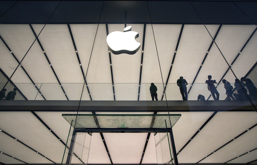 Apple logo on a glass-fronted building