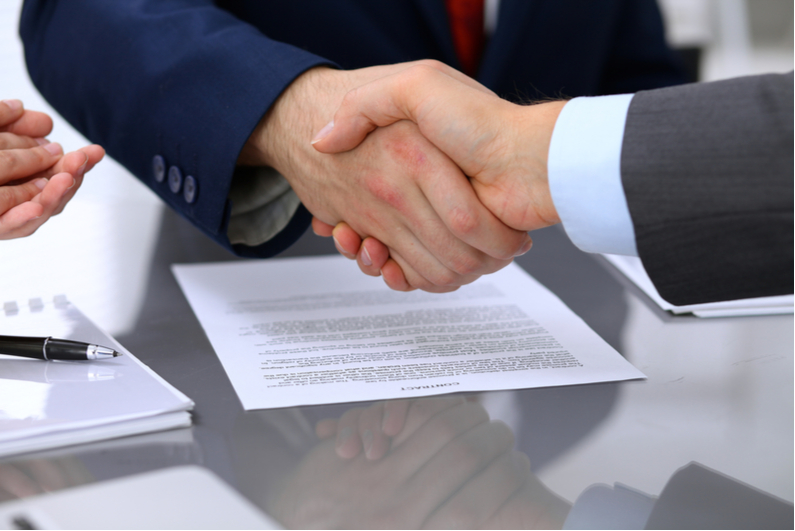Businessmen shaking hands on a deal