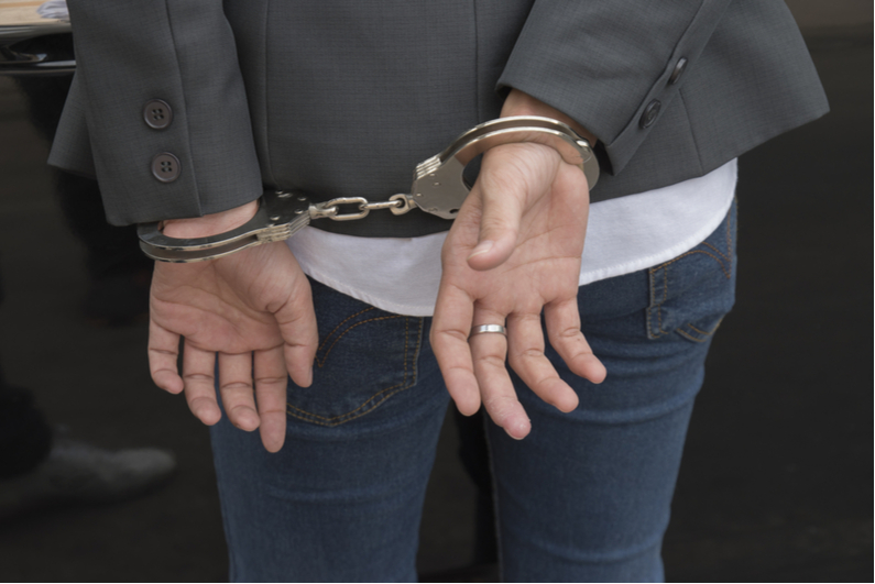 Handcuffs on woman's wrists