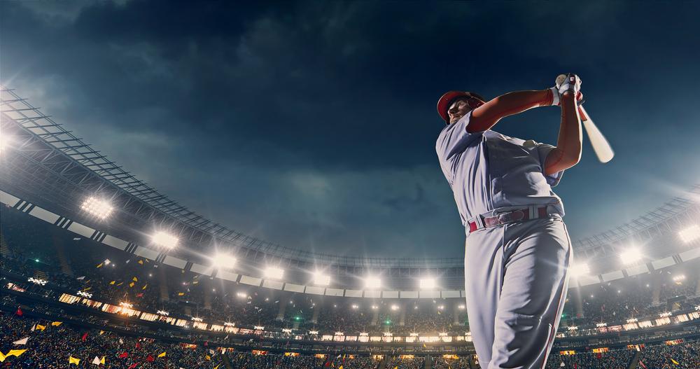 baseball player holding bat on pitch
