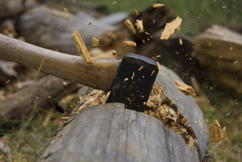 Axe cutting wood.