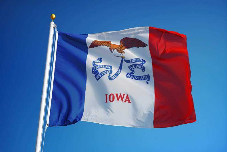 iowa-state-flag-waving-against-clear-blue-sky