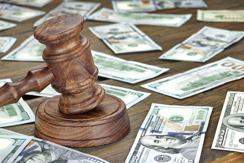 Judge's gavel and money on a table.