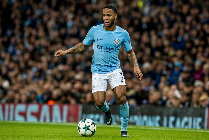 Raheem Sterling playing for Manchester City.