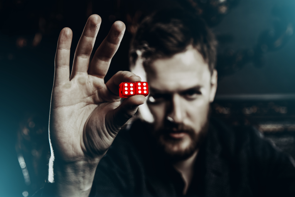 man-holding-a-pair-of-dice