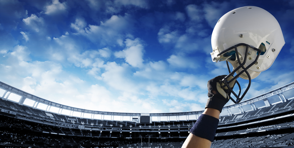 american-football-helmet-raised-in-the-air-inside-football-ground