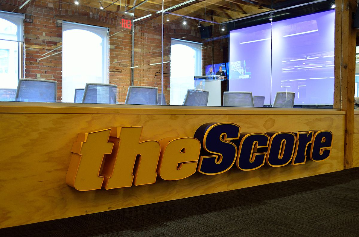 reception desk area with chairs and glass partitioning at theScore company premises