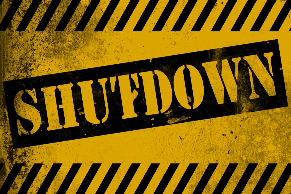 black and yellow shutdown sign