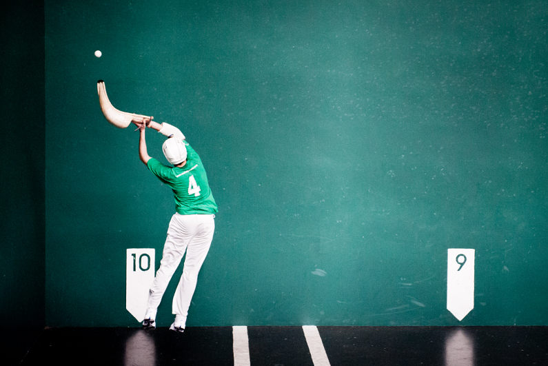 Man playing jai-alai.
