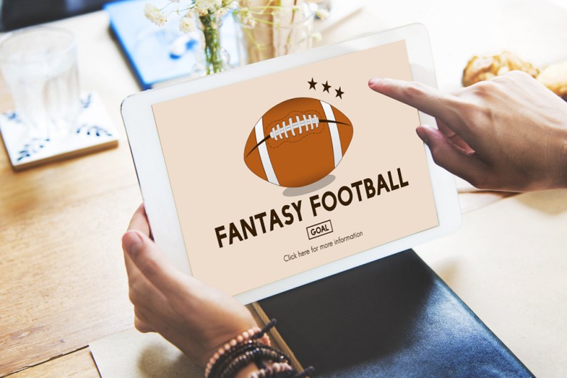 Fantasy football customer using a tablet.