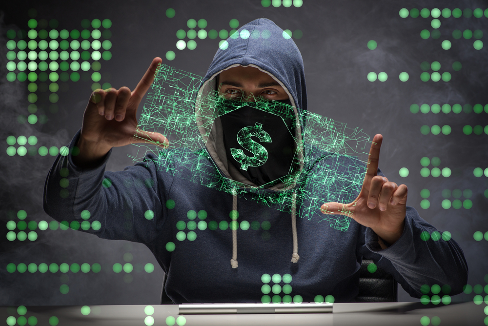 cyber hacker trying to steal dollars