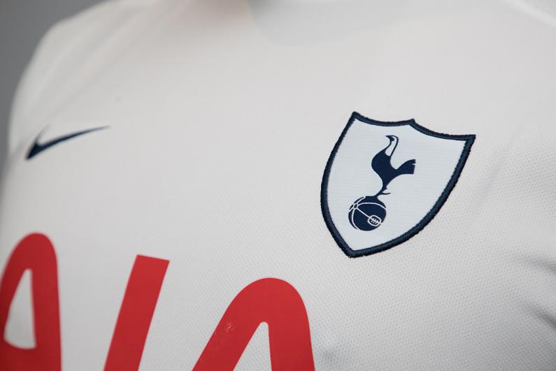Logo of Tottenham Hotspur soccer club printed on jersey.