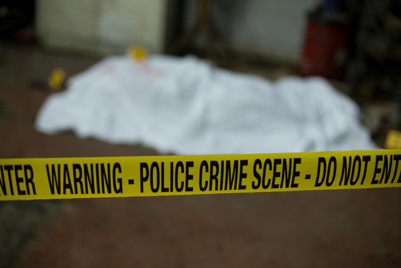 Police tape preserving a crime scene.