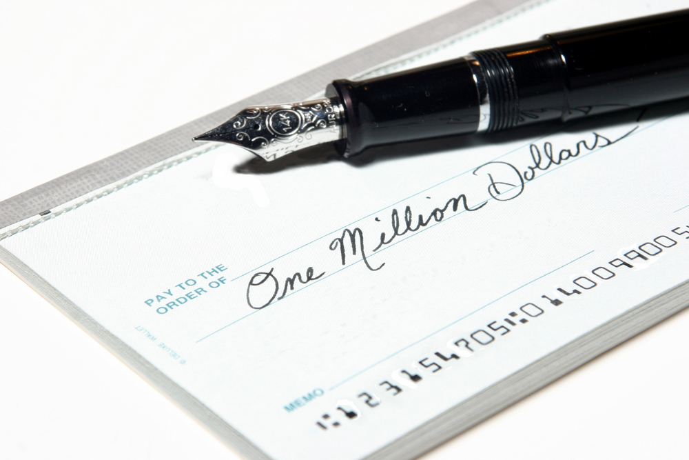 check for one million dollars and fountain pen