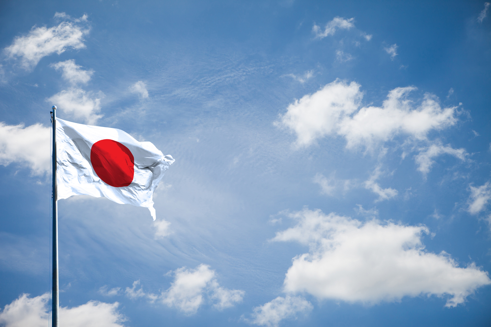 flag of Japan with sunny sky backdrop