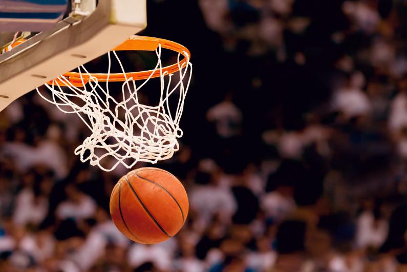 Basketball falling through a net.