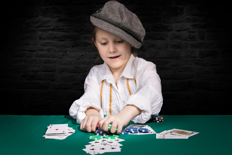female child playing poker