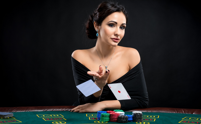 sexy woman throwing two cards at a poker table