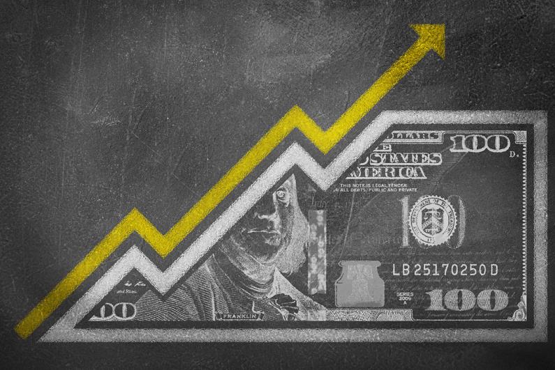 A money bill drawn on a chalk board looking like a growth graph.