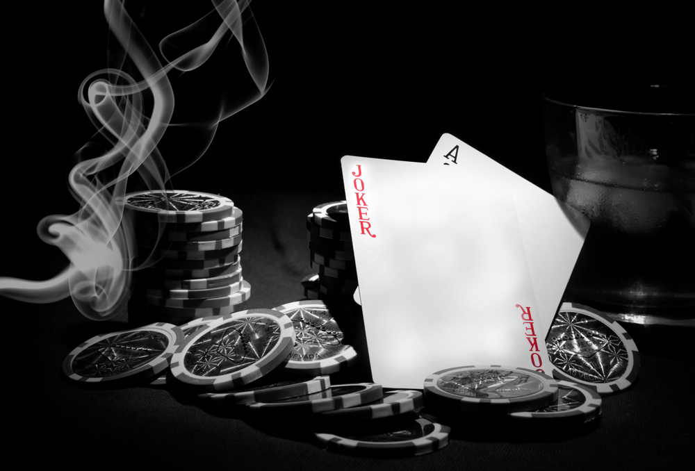 poker chips, cards, table and cigarette smoke