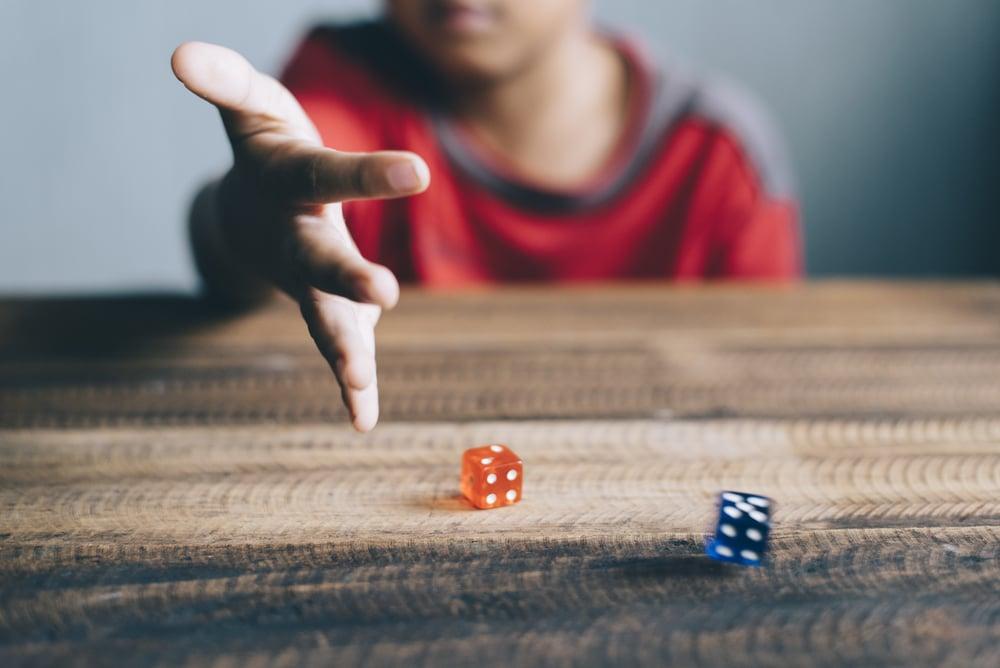 boy rolling dice