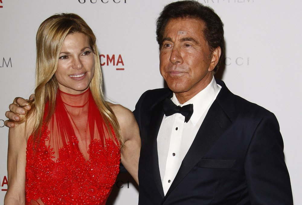 Wynn Resorts founder Steve Wynn posing for photo with woman