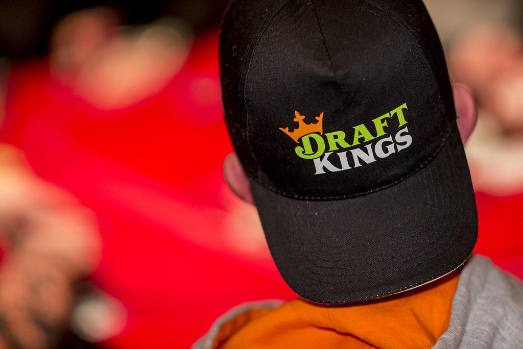 man wearing DraftKings branded cap