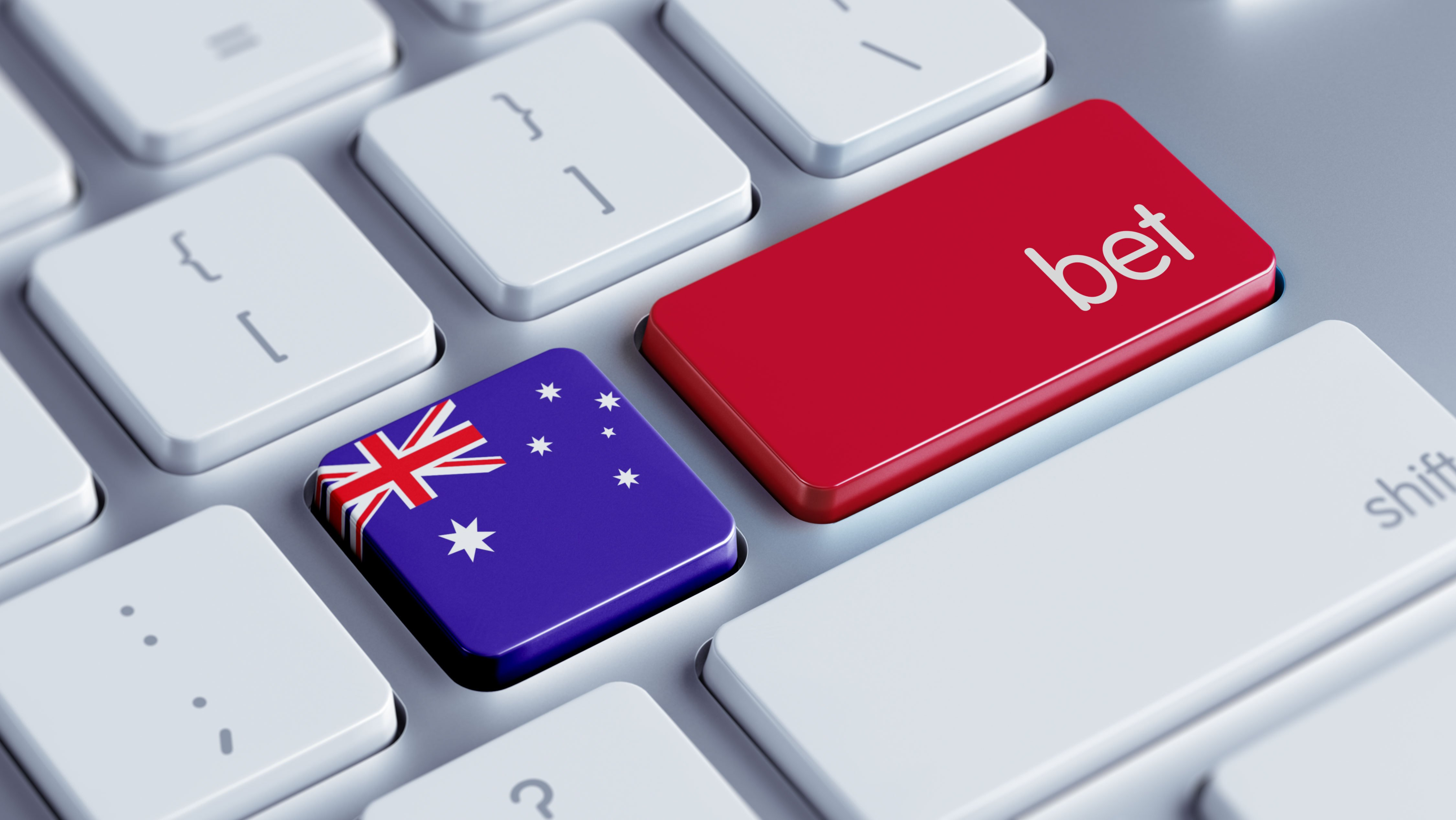 "Computer keyboard with key showing Australian flag and a ""bet"" key"
