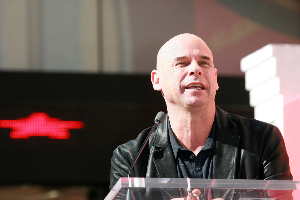 poker player Guy Laliberte speaking on a podium