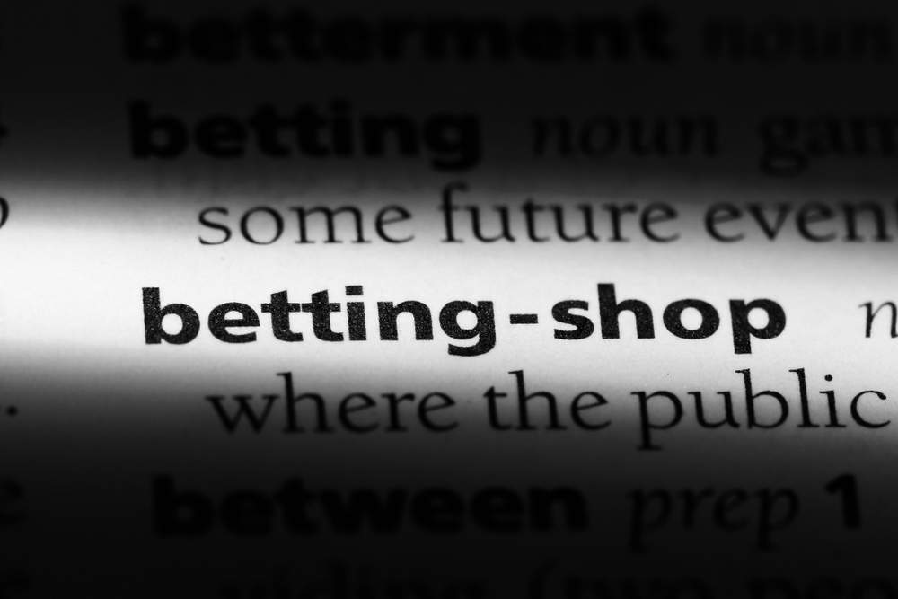 "close-up shot of dictionary entry ""betting shop"""