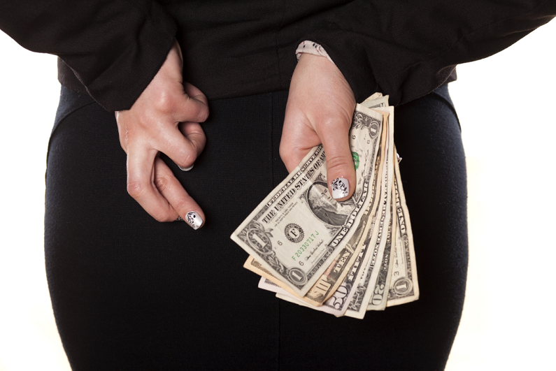 female crossing her fingers and holding money behind her back
