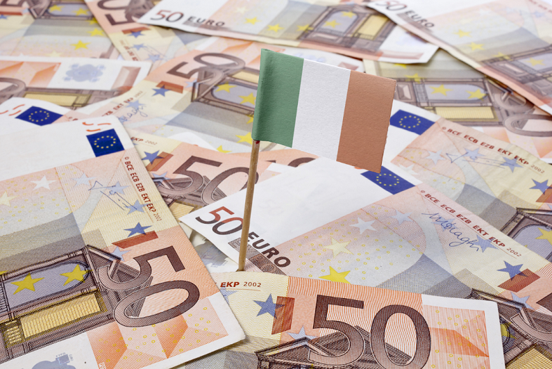 flag of Ireland sticking in european banknotes