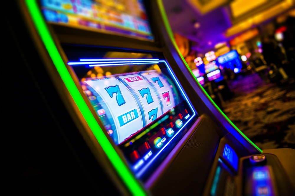 777 land on slot machine reels inside gambling establishment