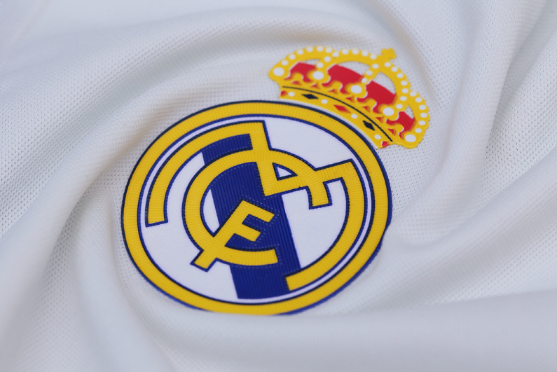 Real Madrid badge on white jersey