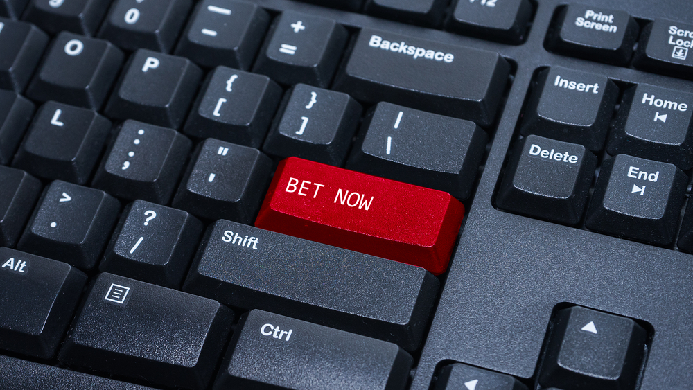 keyboard enter button reading bet now