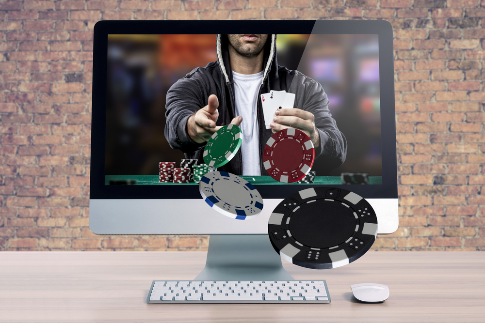 online poker representation shows player on desktop throwing chips through the screen