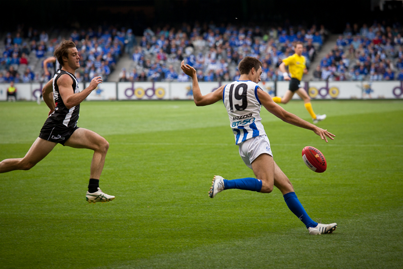 North Melbourne's Sam Wright kicks during their loss to Collingwood in April 2011