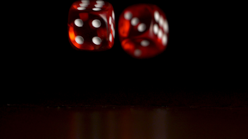 Two red dice suspended