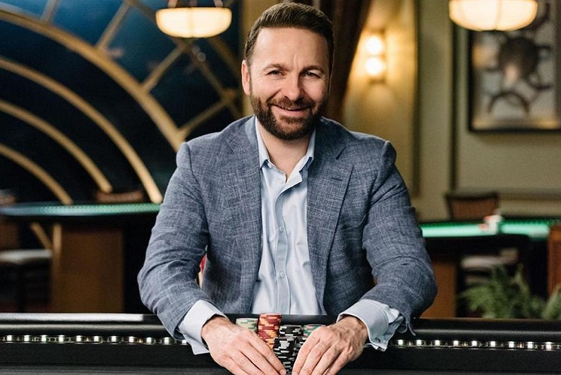 Daniel Negreanu sitting at poker table