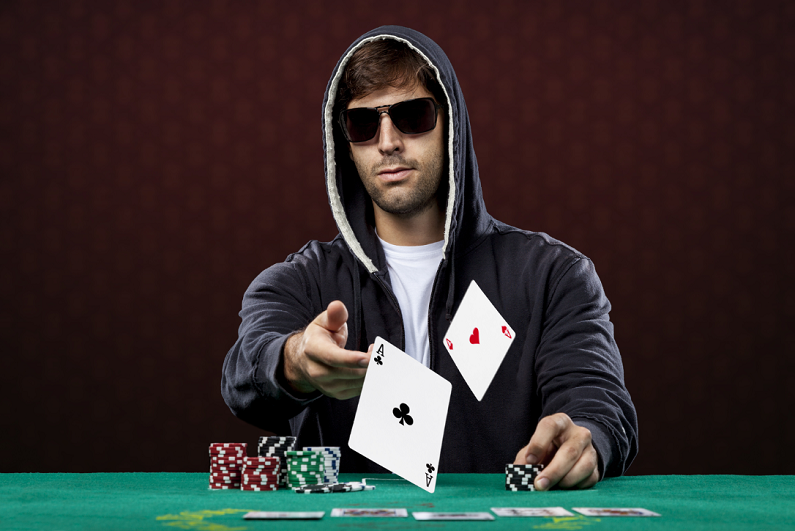 poker player, on a red background, throwing two ace cards