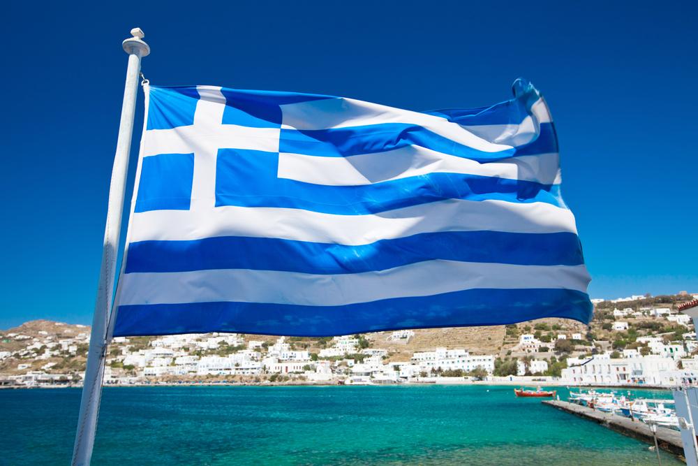 flag of Greece against Mediterranean island background