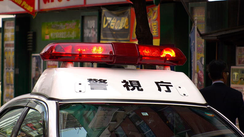 red lights on a Japanese police car