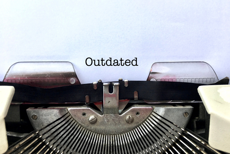 'Outdated' printed using a typewriter