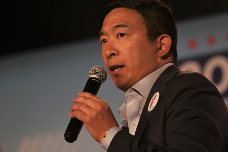 Andrew Yang speaks to the crowd at a forum for presidential candidates