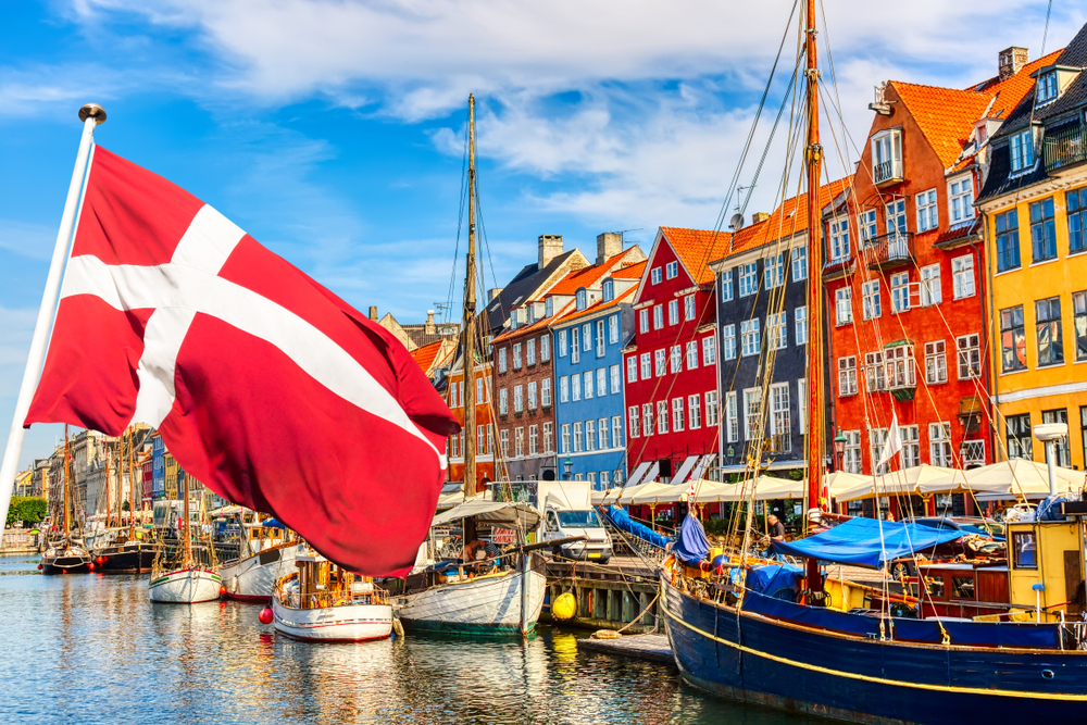 flag of Denmark with Copenhagen scene in the background