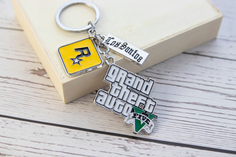GTA 5 keyring on wooden background