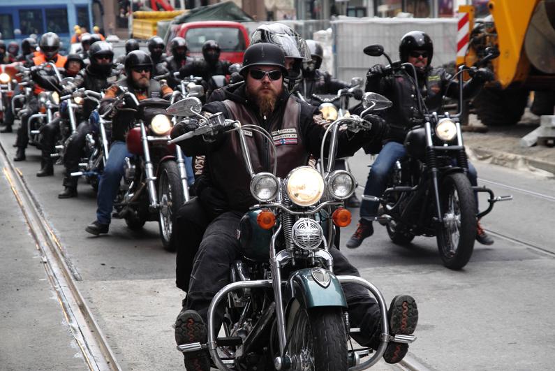 bikers riding through a street